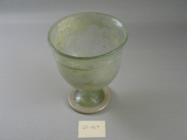 Roman. <em>Goblet of Plain Blown Glass</em>, 1st-5th century C.E. Glass, 4 5/16 x Diam. 3 11/16 in. (11 x 9.3 cm). Brooklyn Museum, Gift of Robert B. Woodward, 01.417. Creative Commons-BY (Photo: Brooklyn Museum, CUR.01.417_view1.jpg)