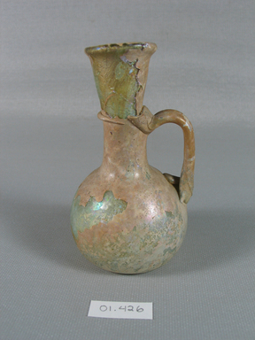 Roman. <em>Jug of Blown Glass</em>, 1st-5th century C.E. Glass, 3 3/4 x Diam. 2 1/16 in. (9.6 x 5.3 cm). Brooklyn Museum, Gift of Robert B. Woodward, 01.426. Creative Commons-BY (Photo: Brooklyn Museum, CUR.01.426_view1.jpg)