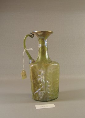 Roman. <em>Hexagonal Jug with Molded Pattern</em>, 6th-early 7th century C.E. Glass, 6 7/16 x 2 13/16 x 3 9/16 in. (16.3 x 7.2 x 9.1 cm). Brooklyn Museum, Gift of Robert B. Woodward, 01.431. Creative Commons-BY (Photo: Brooklyn Museum, CUR.01.431_view1.jpg)