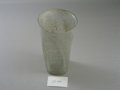 Roman. <em>Tumbler of Blown Glass</em>, 3rd-4th century C.E. Glass, 4 9/16 x Diam. 2 3/8 in. (11.6 x 6 cm). Brooklyn Museum, Gift of Robert B. Woodward, 01.44. Creative Commons-BY (Photo: Brooklyn Museum, CUR.01.44_view1.jpg)
