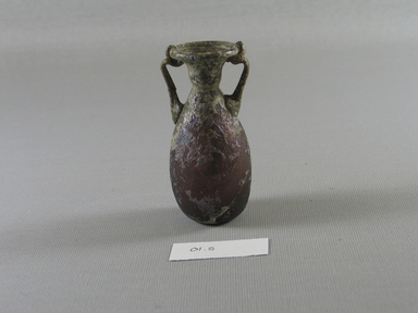 Roman. <em>Amphora-like Bottle of Blown Glass</em>, 1st-5th century C.E. Glass, 3 1/16 x 1 1/2 in. (7.8 x 3.8 cm). Brooklyn Museum, Gift of Robert B. Woodward, 01.65. Creative Commons-BY (Photo: Brooklyn Museum, CUR.01.65_view1.jpg)