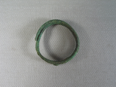 <em>Child's Bracelet</em>, 30 B.C.E.-395 C.E. Bronze, 3/8 × 1 9/16 × 1 5/8 in. (1 × 4 × 4.2 cm). Brooklyn Museum, Gift of the Egypt Exploration Fund, 02.233. Creative Commons-BY (Photo: , CUR.02.233_view01.jpg)
