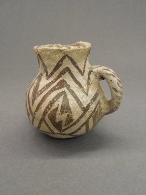 Ancient Pueblo (Anasazi). <em>Miniature Pitcher</em>, 750-1350. Clay, slip, 2 1/2 x 2 3/4 in. (6.4 x 7 cm). Brooklyn Museum, Gift of Charles A. Schieren, 02.256.2255. Creative Commons-BY (Photo: Brooklyn Museum, CUR.02.256.2255.jpg)
