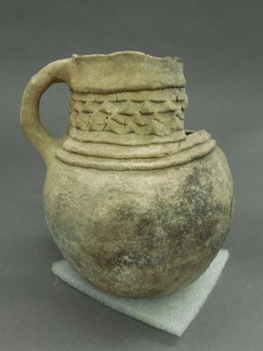 Ancient Pueblo (Anasazi). <em>Pitcher</em>. Clay, slip, 6 1/8 x 5 5/8 in. (15.6 x 14.3 cm). Brooklyn Museum, Gift of Charles A. Schieren, 02.259.2684. Creative Commons-BY (Photo: Brooklyn Museum, CUR.02.259.2684.jpg)