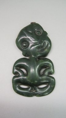 Maori. <em>Pendant (Hei-tiki)</em>, before 18th century. Nephrite, fiber, 4 5/16 x 2 3/8 x 5/16 in.  (11 x 6 x .8 cm). Brooklyn Museum, Brooklyn Museum Collection, 03.213. Creative Commons-BY (Photo: Brooklyn Museum, CUR.03.213.jpg)