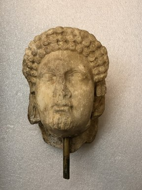 Roman. <em>Head of Apollo</em>, late 1st century B.C.E., probably. Marble, 8 7/16 × 5 11/16 × 6 5/16 in. (21.5 × 14.5 × 16 cm). Brooklyn Museum, Gift of Carll H. de Silver, 03.285. Creative Commons-BY (Photo: , CUR.03.285_view01.jpg)