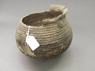 Ancient Pueblo (Anasazi). <em>Coiled Cooking Pot</em>, Probably 900-1100, Pueblo II. Clay, 6 1/8 x 6 1/2 in. (15.6 x 16.5 cm). Brooklyn Museum, Museum Expedition 1903, Purchased with funds given by A. Augustus Healy and George Foster Peabody, 03.325.11026. Creative Commons-BY (Photo: Brooklyn Museum, CUR.03.325.11026.jpg)