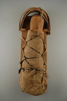 She-we-na (Zuni Pueblo). <em>Doll in Cradle (Wi-ha Yas-to)</em>, 19th century. Wood, cotton fabric, iron nails, 14 1/2 x 5 1/2 x 3 1/4 in. (36.4 x 14.6 x 10.7 cm). Brooklyn Museum, Museum Expedition 1903, Museum Collection Fund, 03.325.3195. Creative Commons-BY (Photo: Brooklyn Museum, CUR.03.325.3195_front.jpg)