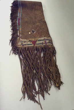 Ute. <em>Saddle Bag (Atlsa Asisi)</em>. Hide, glass trade beads, cloth, 67 x 14 1/2 in. (120.0 x 37.5 cm). Brooklyn Museum, Museum Expedition 1903, Museum Collection Fund, 03.325.3768. Creative Commons-BY (Photo: Brooklyn Museum, CUR.03.325.3768_view1.jpg)