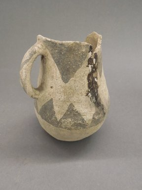 Ancient Pueblo (Anasazi). <em>Pitcher</em>, 600-750 (probably). Clay, slip, 4 1/2 x 2 1/4 in. (11.4 x 5.7 cm). Brooklyn Museum, Museum Expedition 1903, Museum Collection Fund, 03.325.4193. Creative Commons-BY (Photo: Brooklyn Museum, CUR.03.325.4193.jpg)