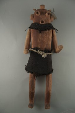 She-we-na (Zuni Pueblo). <em>Kachina Doll (Pakwen [Clown])</em>, late 19th century. Wood, pigment, wool, feather, 16 1/4 x 6 x 5 1/2 in. (41.3 x 15.2 x 14 cm). Brooklyn Museum, Museum Expedition 1903, Museum Collection Fund, 03.325.4606. Creative Commons-BY (Photo: Brooklyn Museum, CUR.03.325.4606_front.jpg)