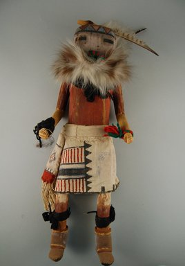 She-we-na (Zuni Pueblo). <em>Kachina Doll (Apache)</em>, late 19th century. Feathers, wood, pigment, cloth, yarn, fur, nails, hide, string, 6 7/16 x 3 1/8 x 18in. (16.4 x 7.9 x 45.7cm). Brooklyn Museum, Museum Expedition 1903, Museum Collection Fund, 03.325.4611. Creative Commons-BY (Photo: Brooklyn Museum, CUR.03.325.4611_front.jpg)