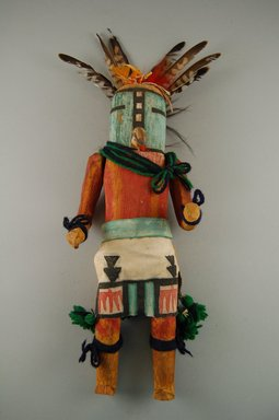 She-we-na (Zuni Pueblo). <em>Kachina Doll (Kjaweya)</em>, late 19th century. Turquoise, feathers, yarn, wood, cloth, string, pigment, nails, hair, 16 9/16 x 12 15/16in. (42 x 32.8cm). Brooklyn Museum, Museum Expedition 1903, Museum Collection Fund, 03.325.4617. Creative Commons-BY (Photo: Brooklyn Museum, CUR.03.325.4617_front.jpg)