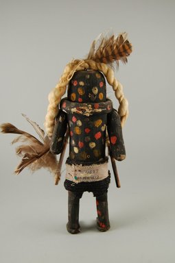 She-we-na (Zuni Pueblo). <em>Kachina Doll (Schutawetsa Kweha)</em>, late 19th century. Wood, pigment, fabric, feather, yarn, 9 x 1 1/16 in. (22.9 x 2.8 cm). Brooklyn Museum, Museum Expedition 1903, Museum Collection Fund, 03.325.4637. Creative Commons-BY (Photo: Brooklyn Museum, CUR.03.325.4637_back.jpg)