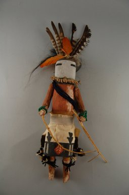 She-we-na (Zuni Pueblo). <em>Kachina Doll (Zum Tsehapa)</em>, late 19th century. Feathers, yarn, wood, cloth, string, hair, pigment, nails, fiber, feathers, 11 13/16 x 2 3/8 x 4 3/16 in.  (30.0 x 6.1 x 10.6 cm). Brooklyn Museum, Museum Expedition 1903, Museum Collection Fund, 03.325.4641. Creative Commons-BY (Photo: Brooklyn Museum, CUR.03.325.4641_front.jpg)