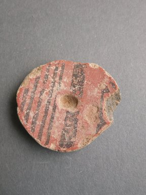 Southwest (unidentified). <em>Disk with Red and Black Stripes</em>. Clay, 1 3/8 x 3/16 in (4.3 x 3.8 cm). Brooklyn Museum, Museum Expedition 1903, Museum Collection Fund, 03.325.4961. Creative Commons-BY (Photo: Brooklyn Museum, CUR.03.325.4961.jpg)