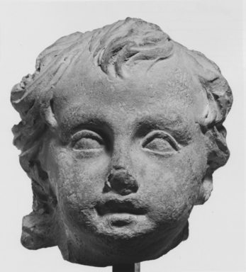 Roman. <em>Child's Head from a Statuette</em>, 30 B.C.E.-395 C.E. Clay Brooklyn Museum, Purchase gift of Robert B. Woodward and Carll H. de Silver, 04.22. Creative Commons-BY (Photo: , CUR.04.22_NegA_print_bw.jpg)