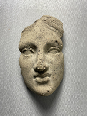 Possibly Greek. <em>Votive Mask</em>, 1000 B.C.E. Terracotta, 6 11/16 × 4 15/16 × 3 9/16 in. (17 × 12.5 × 9 cm). Brooklyn Museum, Purchase gift of Robert B. Woodward and Carll H. de Silver, 04.24. Creative Commons-BY (Photo: Brooklyn Museum, CUR.04.24_view01.jpeg)