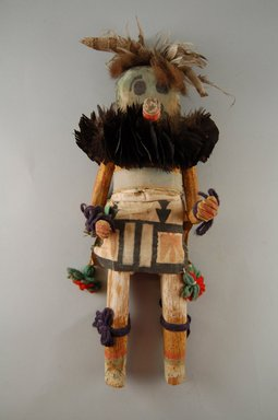 Mau-i (She-we-na (Zuni Pueblo)). <em>Kachina Doll (Thlecheche)</em>, late 19th-early 20th century. Feathers, buffalo fur, wood, pigment, cotton, yarn, 16 1/4 × 6 1/2 × 4 3/4 in. (41.3 × 16.5 × 12.1 cm). Brooklyn Museum, Museum Expedition 1904, Museum Collection Fund, 04.297.5333. Creative Commons-BY (Photo: Brooklyn Museum, CUR.04.297.5333_front.jpg)