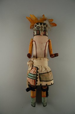 Mau-i (She-we-na (Zuni Pueblo)). <em>Kachina Doll (Panek Pinto)</em>, late 19th-early 20th century. Wood, pigment, feathers, yarn, cotton, 13 3/8 x 4 11/16 x 3 1/16in. (34 x 11.9 x 7.8cm). Brooklyn Museum, Museum Expedition 1904, Museum Collection Fund, 04.297.5348. Creative Commons-BY (Photo: Brooklyn Museum, CUR.04.297.5348_front.jpg)