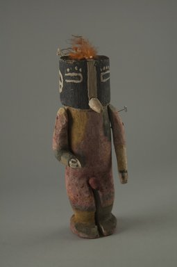 Hopi Pueblo. <em>Kachina Doll (Kokopol, Kokopelli)</em>, late 19th century. Wood, pigment, feathers, cotton cord, 1 3/4 x 3 1/16 x 6 11/16in. (4.5 x 7.8 x 17cm). Brooklyn Museum, Museum Expedition 1904, Museum Collection Fund, 04.297.5595. Creative Commons-BY (Photo: Brooklyn Museum, CUR.04.297.5595_front.jpg)