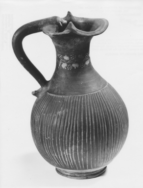Italiote. <em>Oinochoe</em>, late 4th-3rd century B.C.E. Clay, slip, 9 15/16 x greatest diam. 5 7/8 in. (25.2 x 14.9 cm). Brooklyn Museum, Purchase gift of Robert B. Woodward and Carll H. de Silver, 04.9. Creative Commons-BY (Photo: Brooklyn Museum, CUR.04.9_NegA_print_bw-1.jpg)
