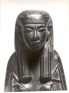 <em>Fragmentary Ushabti of a Man Named Roy</em>, ca. 1539-1190 B.C.E. Stone, 6 3/4 x width at elbows 2 7/8 in. (17.2 x 7.3 cm). Brooklyn Museum, Charles Edwin Wilbour Fund, 05.313. Creative Commons-BY (Photo: Brooklyn Museum, CUR.05.313_negL_166_11_bw.jpg)