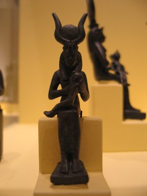 <em>Small Bronze Statuette of Isis Holding Horus</em>, 664–30 B.C.E. Bronze, 4 1/16 x 1 1/16 x 1 7/16 in. (10.3 x 2.7 x 3.7 cm). Brooklyn Museum, Charles Edwin Wilbour Fund, 05.315. Creative Commons-BY (Photo: Brooklyn Museum, CUR.05.315_pqg.jpg)