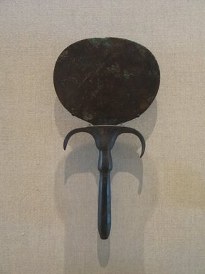 <em>Mirror with Handle in the Form of Papyrus Column, with Large Umbel</em>, ca. 2040-1801 B.C.E. Bronze, 9 1/4 × 4 15/16 in. (23.5 × 12.5 cm). Brooklyn Museum, Charles Edwin Wilbour Fund, 05.321. Creative Commons-BY (Photo: Brooklyn Museum, CUR.05.321_wwgA-1.jpg)