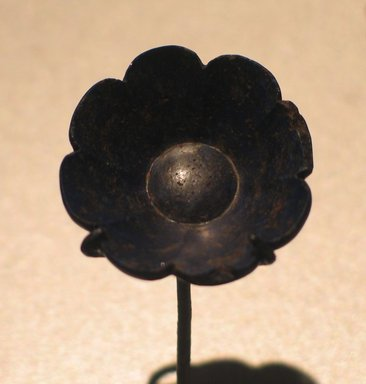 <em>Flower</em>, ca. 1539-1292 B.C.E. Lapis lazuli, 3/4 x greatest diam. 1 1/4 in. (1.9 x 3.1 cm). Brooklyn Museum, Charles Edwin Wilbour Fund, 05.326. Creative Commons-BY (Photo: Brooklyn Museum, CUR.05.326_erg456.jpg)