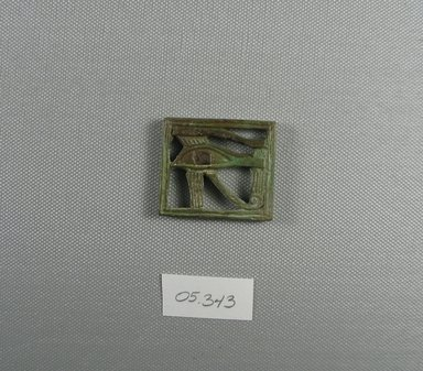 <em>Wadjet-eye Plaque</em>, 664–30 B.C.E. Faience, 1 7/16 x 1/4 x 1 11/16 in. (3.7 x 0.6 x 4.3 cm). Brooklyn Museum, Charles Edwin Wilbour Fund, 05.343. Creative Commons-BY (Photo: Brooklyn Museum, CUR.05.343_view1.jpg)