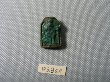 <em>Plaque Depicting Sakhmet or Bast</em>, ca. 1075-332 B.C.E. Faience, 7/8 × 11/16 × 1/4 in. (2.3 × 1.7 × 0.7 cm). Brooklyn Museum, Charles Edwin Wilbour Fund, 05.369. Creative Commons-BY (Photo: , CUR.05.369_view01.jpg)