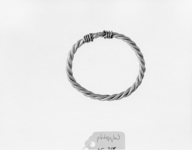 <em>Bracelet Composed of Two Heavy Undecorated Bands Braided to Form a Loop</em>, 2nd century C.E. Gold, 1 5/8 x (Diam.) 1 7/8 in. (4.2 x 4.7 cm). Brooklyn Museum, Charles Edwin Wilbour Fund, 05.388. Creative Commons-BY (Photo: , CUR.05.388_NegA_print_bw.jpg)