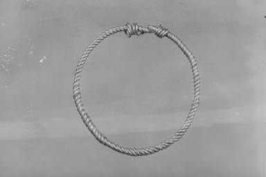 Roman. <em>Small Bracelet Composed of Two Rather Fine Bands Looped in Coil Form to Form a Loop</em>, 2nd century C.E. Gold, 2 1/16 x 1 15/16 in. (5.3 x 4.9 cm). Brooklyn Museum, Charles Edwin Wilbour Fund, 05.389. Creative Commons-BY (Photo: , CUR.05.389_NegA_print_bw.jpg)