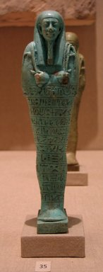 <em>Shabty of Meshshentayet</em>, 664-332 B.C.E. Faience, 7 13/16 x 2 x depth of base 1 9/16 in. (19.8 x 5.1 x 4 cm). Brooklyn Museum, Charles Edwin Wilbour Fund, 05.401. Creative Commons-BY (Photo: Brooklyn Museum, CUR.05.401_wwgA-3.jpg)