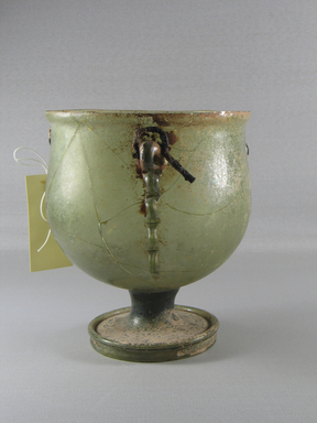Roman. <em>Vase of Light Olive-green Blown Glass</em>, 1st-4th century C.E. Glass, 7 1/2 x Diam. 6 7/8 in. (19 x 17.5 cm). Brooklyn Museum, Gift of R. B. Woodward, 05.41. Creative Commons-BY (Photo: Brooklyn Museum, CUR.05.41_view3.jpg)