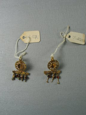 Roman. <em>Pair of Earrings</em>, 3rd century C.E. Gold, glass, garnet, 9/16 x 1 15/16 in. (1.4 x 5 cm). Brooklyn Museum, Ella C. Woodward Memorial Fund, 05.427.1-.2. Creative Commons-BY (Photo: Brooklyn Museum, CUR.05.427.1-.2_overall.jpg)