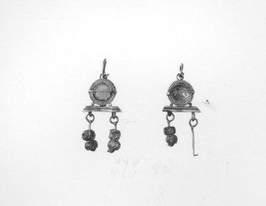 Roman. <em>Pair of Earrings</em>, 3rd century C.E. Gold, glass, 1/2 x 1 1/4 in. (1.3 x 3.1 cm). Brooklyn Museum, Ella C. Woodward Memorial Fund, 05.434a-b. Creative Commons-BY (Photo: Brooklyn Museum, CUR.05.434a-b_NegA_print_bw.jpg)