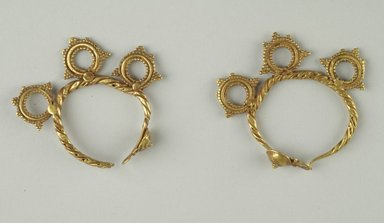 <em>Pair of Earrings</em>, 6th century C.E. Gold, 2 1/8 in. (5.4 cm). Brooklyn Museum, Ella C. Woodward Memorial Fund, 05.443a-b. Creative Commons-BY (Photo: Brooklyn Museum (in collaboration with Index of Christian Art, Princeton University), CUR.05.443a-b_view1_ICA.jpg)