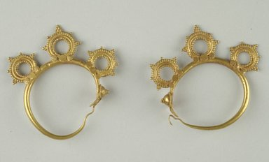 <em>Pair of Earrings</em>, 6th century C.E. Gold, 2 in. (5.1 cm). Brooklyn Museum, Ella C. Woodward Memorial Fund, 05.444a-b. Creative Commons-BY (Photo: Brooklyn Museum (in collaboration with Index of Christian Art, Princeton University), CUR.05.444a-b_view1_ICA.jpg)
