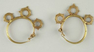 <em>Pair of Earrings</em>, 6th century C.E. Gold, 2 in. (5.1 cm). Brooklyn Museum, Ella C. Woodward Memorial Fund, 05.445a-b. Creative Commons-BY (Photo: Brooklyn Museum (in collaboration with Index of Christian Art, Princeton University), CUR.05.445a-b_view1_ICA.jpg)
