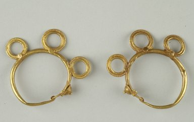 <em>Pair of Earrings</em>, 6th century C.E. Gold, a: 1 13/16 in. (4.6 cm). Brooklyn Museum, Ella C. Woodward Memorial Fund, 05.446a-b. Creative Commons-BY (Photo: Brooklyn Museum (in collaboration with Index of Christian Art, Princeton University), CUR.05.446a-b_view1_ICA.jpg)