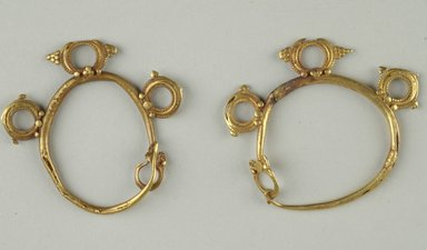 <em>Pair of Earrings</em>, 6th century C.E. Gold, Length: 1 11/16 in. (4.3 cm). Brooklyn Museum, Ella C. Woodward Memorial Fund, 05.447a-b. Creative Commons-BY (Photo: Brooklyn Museum (in collaboration with Index of Christian Art, Princeton University), CUR.05.447a-b_view1_ICA.jpg)
