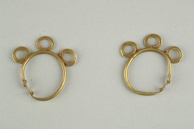 <em>Pair of Earrings</em>, 6th century C.E. Gold, 1 1/2 in. (3.8 cm). Brooklyn Museum, Ella C. Woodward Memorial Fund, 05.448a-b. Creative Commons-BY (Photo: Brooklyn Museum (in collaboration with Index of Christian Art, Princeton University), CUR.05.448a-b_ICA.jpg)