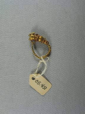 Greek. <em>Single Earring</em>, 2nd-1st century B.C.E. Gold, 1 1/16 x Diam. of loop 3/4 in. (2.7 x 1.9 cm). Brooklyn Museum, Ella C. Woodward Memorial Fund, 05.451. Creative Commons-BY (Photo: Brooklyn Museum, CUR.05.451_view1.jpg)