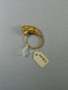 Greek. <em>Large Single Earring</em>, late 4th-3rd century B.C.E. Gold, glass (?), 1 9/16 x Diam. of loop 1 in. (3.9 x 2.5 cm). Brooklyn Museum, Ella C. Woodward Memorial Fund, 05.453. Creative Commons-BY (Photo: Brooklyn Museum, CUR.05.453_view2.jpg)