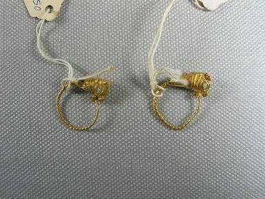 Greek. <em>Pair of Earrings</em>, late 4th century B.C.E.-3rd century B.C.E. Gold, glass, 7/8 x Diam. 11/16 in. (2.3 x 1.7 cm). Brooklyn Museum, Ella C. Woodward Memorial Fund, 05.455.1-.2. Creative Commons-BY (Photo: Brooklyn Museum, CUR.05.455.1-.2_view2.jpg)