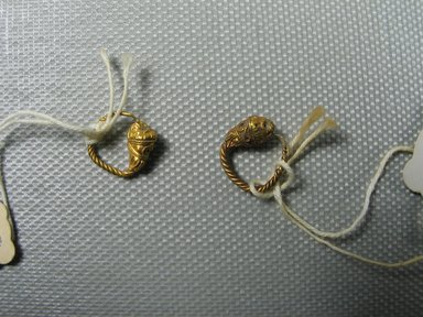Greek. <em>Pair of Small Earrings, Ring Type</em>, late 4th-3rd century B.C.E. Gold, glass, 1/2 in. (1.3 cm). Brooklyn Museum, Ella C. Woodward Memorial Fund, 05.457.1-.2. Creative Commons-BY (Photo: Brooklyn Museum, CUR.05.457.1-.2_view3.jpg)