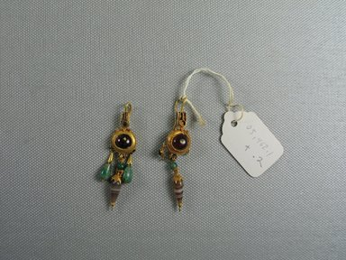 Greek. <em>Pair of Earrings</em>, 2nd-1st century B.C.E. Gold, garnet, glass, emerald, onyx, Length of 05.462.2: 2 3/8 in. (6.1 cm). Brooklyn Museum, Ella C. Woodward Memorial Fund, 05.462.1-.2. Creative Commons-BY (Photo: Brooklyn Museum, CUR.05.462.1-.2_view1.jpg)