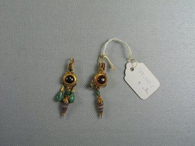 <em>Pair of Earrings</em>, 2nd-1st century B.C.E. Gold, garnet, glass, emerald, onyx, Length of 05.462.2: 2 3/8 in. (6.1 cm). Brooklyn Museum, Ella C. Woodward Memorial Fund, 05.462.1-.2. Creative Commons-BY (Photo: Brooklyn Museum, CUR.05.462.1-.2_view1.jpg)